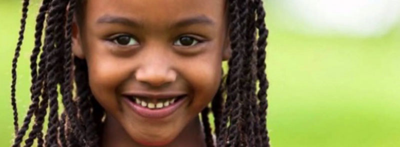 Pretty African American girl smiling.