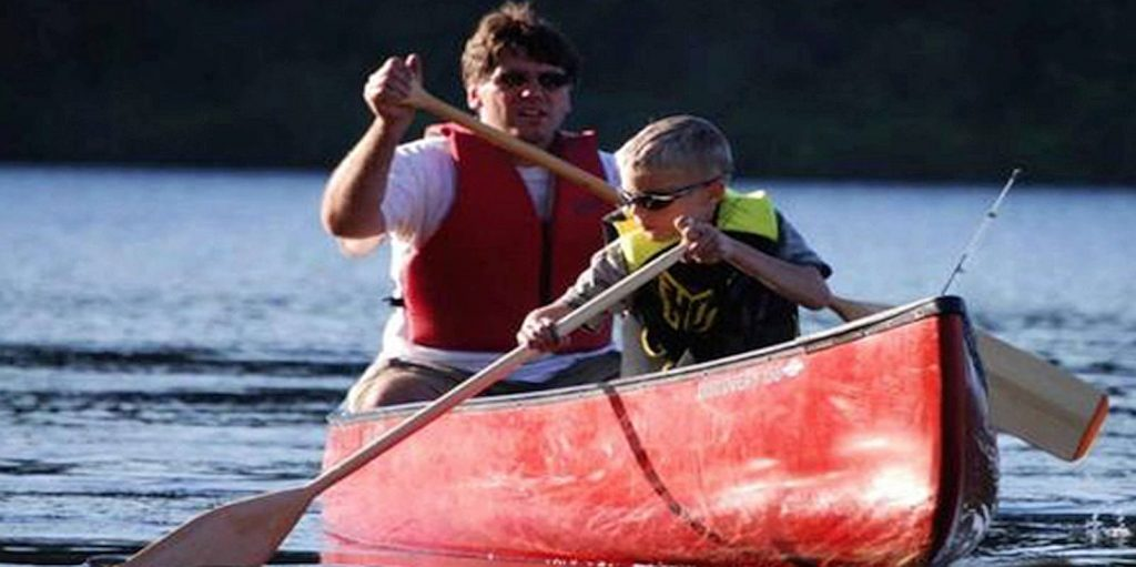 Loving Hands mentor goes boating with young child